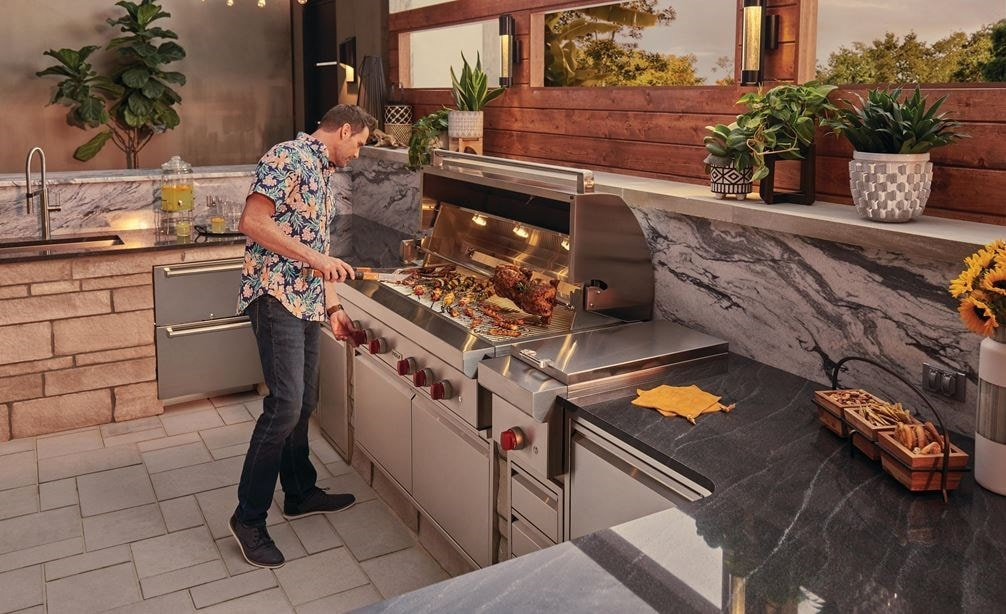 "The Wolf 54"" Outdoor Gas Grill (OG54) paired with Wolf 13"" Classic Burner Module (BM13) for total outdoor kitchen versatility."