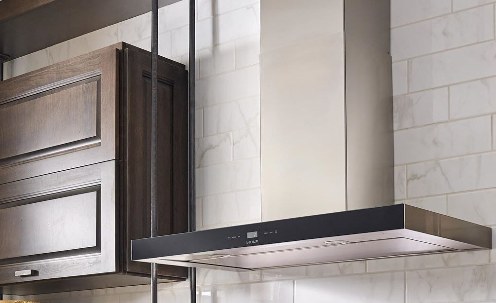"The Wolf 36"" Cooktop Wall Hood - Black (VW36B) shown in a charming contemporary space featuring rustic accents"