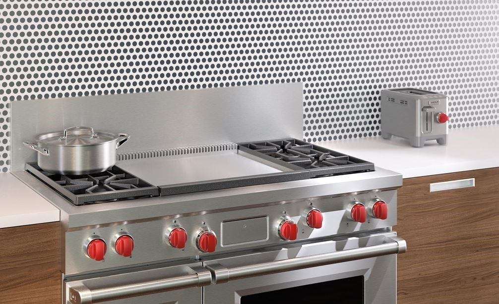 "The Wolf 48"" Dual Fuel Range 4 Burner Infrared Dual Griddle (DF484DG) blends seamlessly with both contemporary backsplash and natural wood cabinetry."