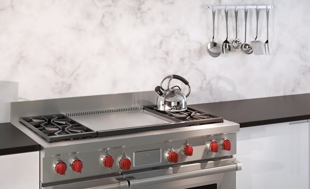 "The Wolf 48"" Dual Fuel Range 4 Burner Infrared Dual Griddle (DF484DG) delivers top performance and blends expertly into minimalist kitchen design."
