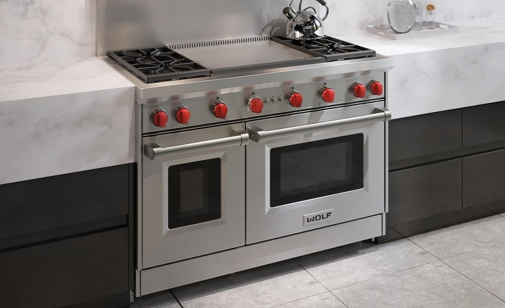 "The Wolf 48"" Gas Range 4 Burner Infrared Dual Griddle (GR484DG) Rangetop featured in a clean modern minimalist kitchen design"