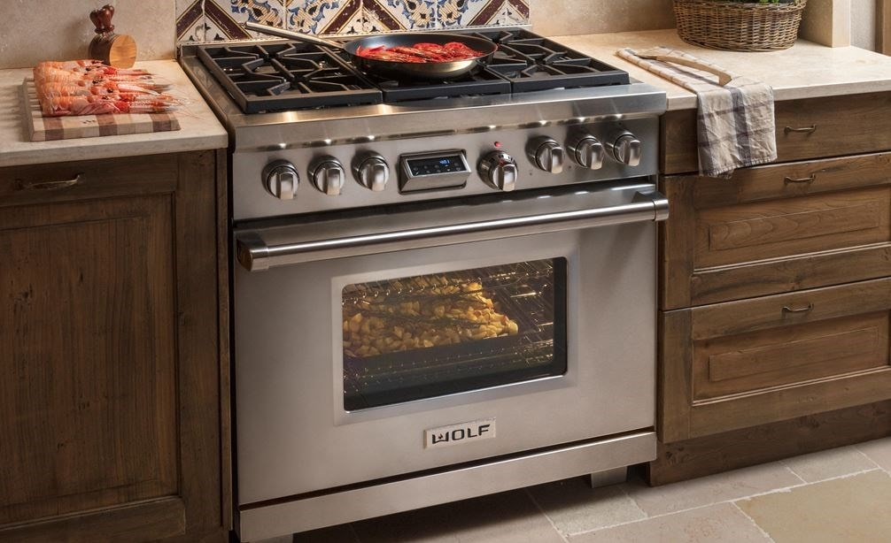 "The Wolf 36"" Dual Fuel Range 6 Burner (DF366) Cooktop shown blending seamlessly in a rustic modern kitchen design."