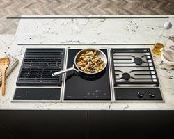 "Wolf 15"" transitional grill module (GM15TFS) paired with a 15"" transitional induction cooktop module (CI152TFS) and 15"" transitional gas cooktop module (CG152TFS)"