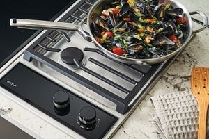 "Wolf 15"" transitional gas cooktop module (CG152TFS) paired with a 15"" transitional electric cooktop module (CE152TFS)"