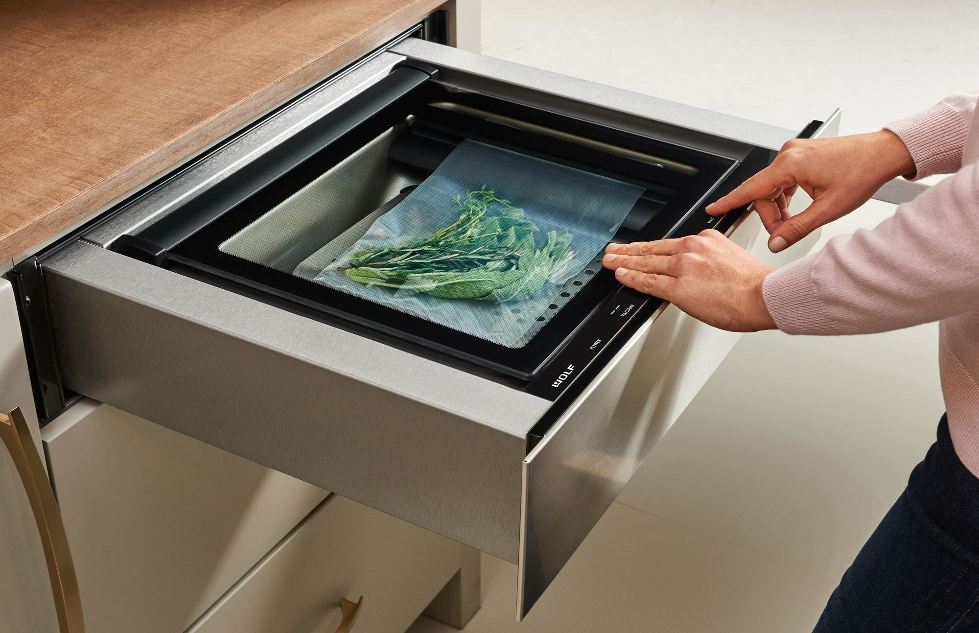 Wolf vacuum seal drawers remove air and seal foods or liquids for easy storage, marinating, and cooking.