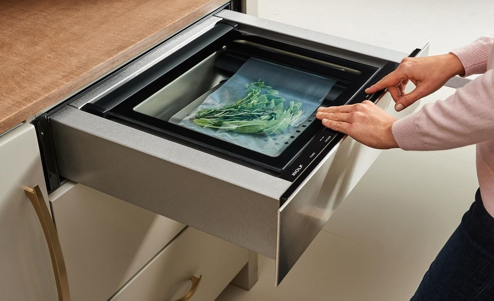 "The Wolf 24"" Vacuum Seal Drawer (VS24) adds the culinary tool professional chefs have enjoyed for years in any custom kitchen design"