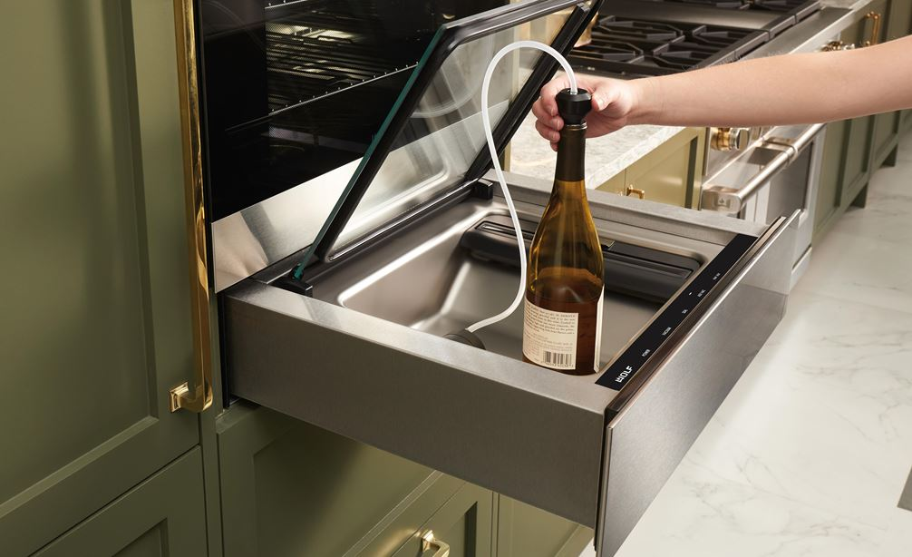 "The Wolf 24"" Vacuum Seal Drawer (VS24) shown protecting and prolonging the life of uncorked wine using the attachment provided"
