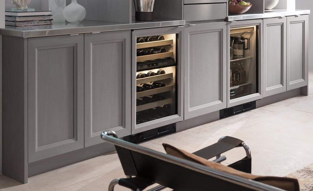 "The Sub-Zero 24"" Undercounter Beverage Center Panel Ready (UC- 24BG/O) paired with 24"" Undercounter Wine Storage (424G/O)"