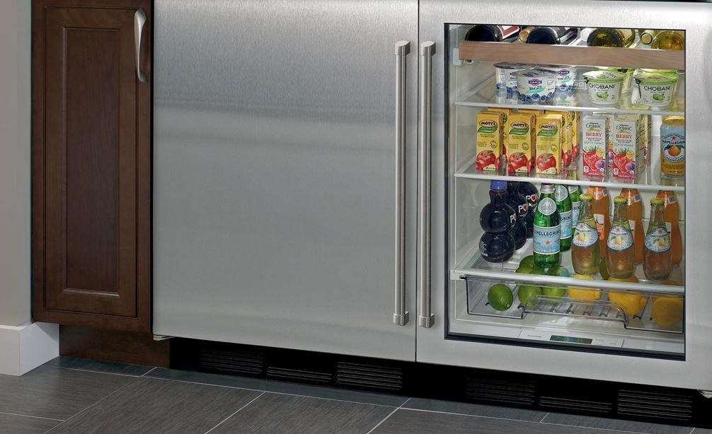"Sub-Zero 24"" Undercounter Refrigerator Freezer (UC-24CI) paired with 24"" Undercounter Beverage Center (UC-24BG/S) provides refrigeration in any room."