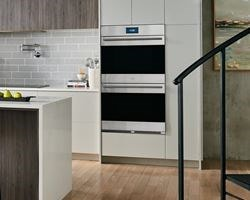 Wolf Dual Wall Ovens featured in an open and spacious luxury kitchen design.