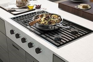 "Wolf 36"" Contemporary Gas Cooktop with 5 Burners has a striking, integrated look, with a cooking surface that sits flush to the countertop"