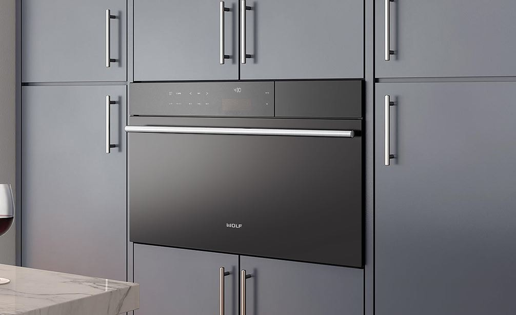 "Wolf 30"" M Series Contemporary Convection Steam Oven (CSO30CM/B/TH) shown with stainless steel handle adds elegance to any room"