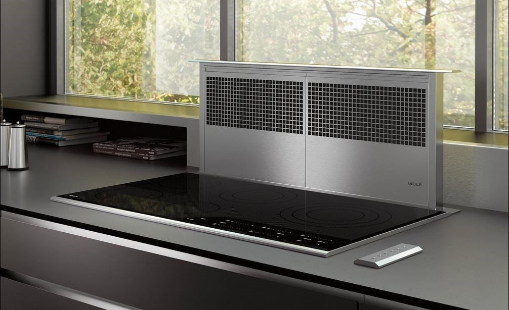"Wolf 36"" Downdraft Ventilation (DD36) shown with 36"" Contemporary Electric Cooktop (CE365C/B) in a luxurious modern kitchen"