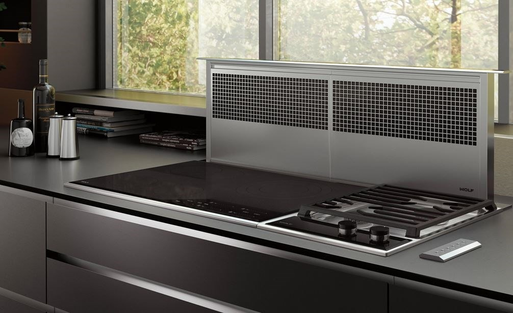 "Wolf 45"" Downdraft Ventilation (DD45) is the finishing touch for this ultra-modern kitchen design featuring smooth countertop and cabinets"