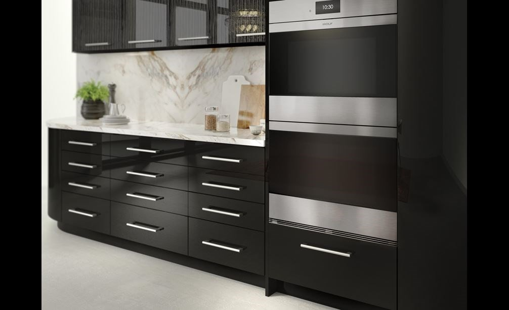 "The Wolf 30"" M Series Contemporary Stainless Steel Double Oven (DO30CM/S) shown blending seamlessly into modern glossy kitchen cabinetry."