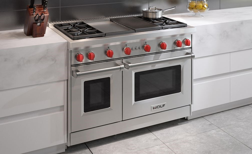 "The Wolf 48"" Gas Range 4 Burner Infrared Charbroiler Infrared Griddle (GR484CG) shown blending seamlessly into a sleek minimalist kitchen design"