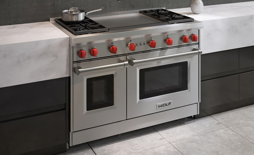 "The Wolf 48"" Gas Range 4 Burner Infrared Dual Griddle (GR484DG) Rangetop featured in a natural urban kitchen design"