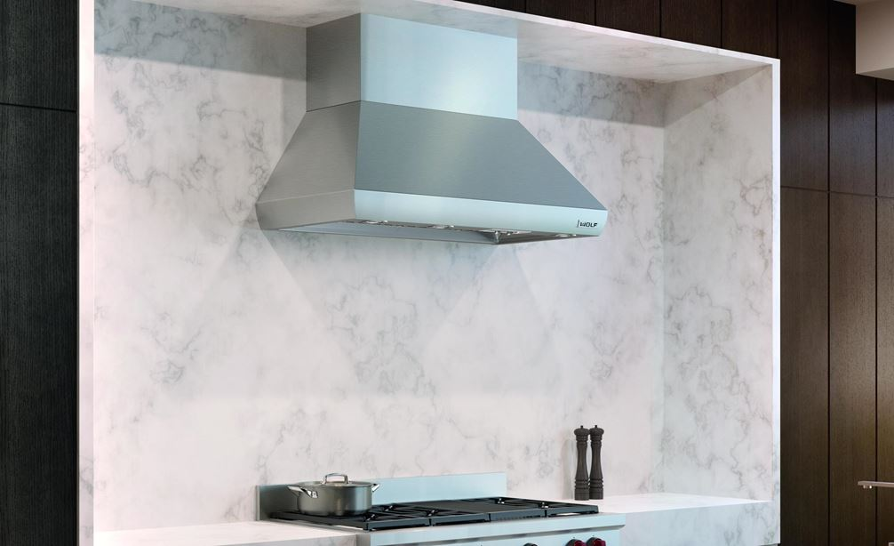 "The Wolf 48"" Sealed 6 Burner Rangetop and Infrared Charbroiler (SRT486C) shown centered in a custom natural stone veneer wall"