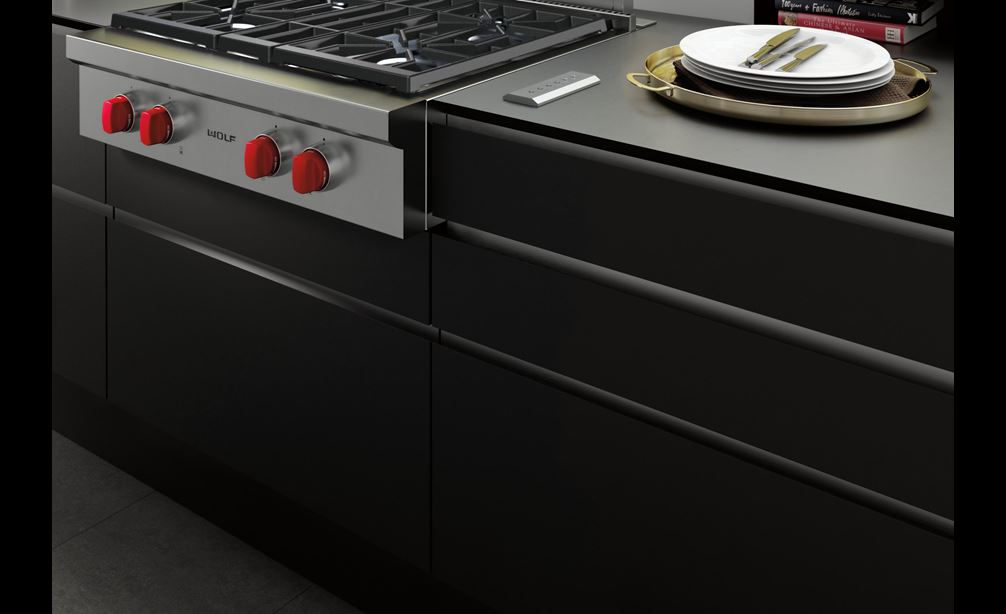 "The Wolf 30"" Downdraft Ventilation (DD30) featured with Wolf 30"" Sealed Burner Rangetop - 4 Burners (SRT304) with signature red knobs"