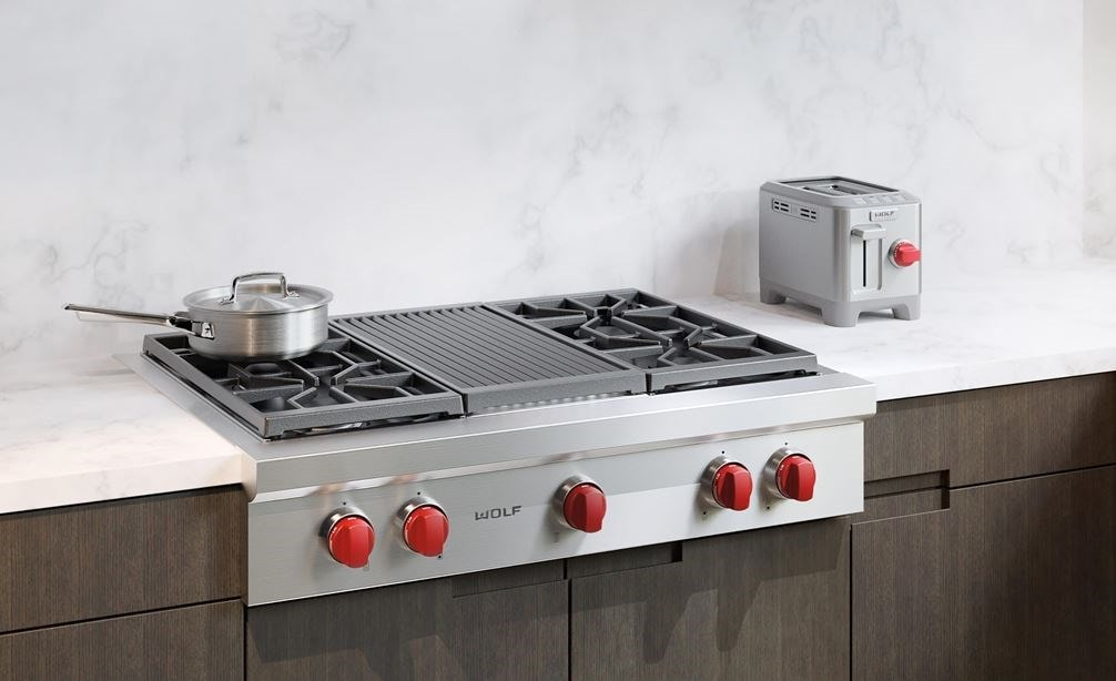 "The Wolf 36"" Sealed 4 Burner Rangetop and Infrared Charbroiler (SRT364C) shown integrated perfectly in a traditional kitchen setting."