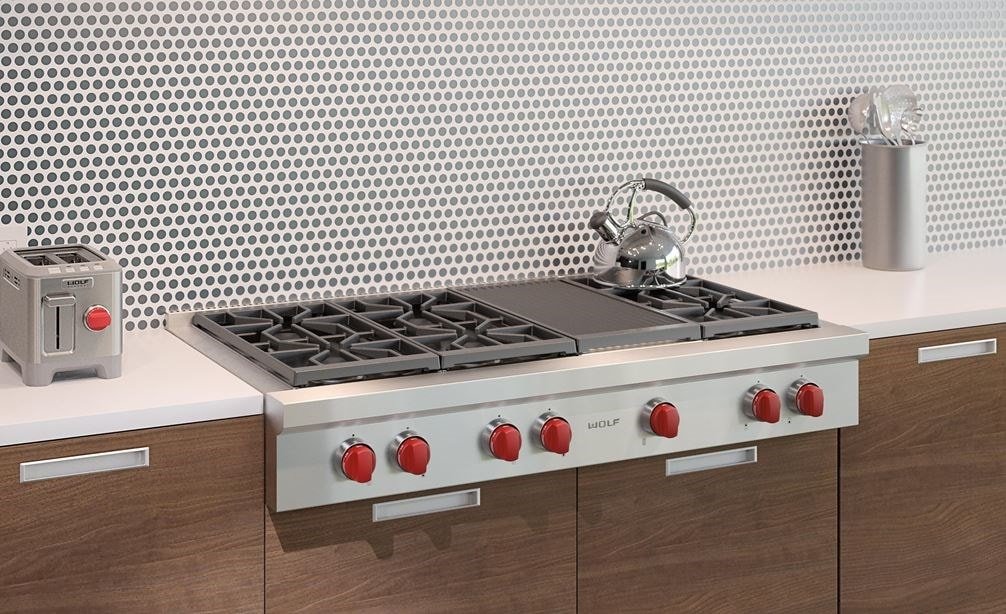 "Wolf 48"" Sealed 6 Burner Rangetop and Infrared Charbroiler (SRT486C) shown in a clean and sleek kitchen with streamlined surfaces"
